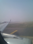 Queue of planes lining to take off after a long fog delay at Delhi airport